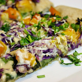 Squash And Cabbage Pizza Drizzled With Tahini Dressing