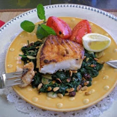 Sea Bass on Spinach With Raisins and Pine Nuts