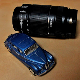 The beauty & the beast? by Anoop Namboothiri - Artistic Objects Toys ( canon, car, toy, blue, automobile, anoop namboothiri, lens )