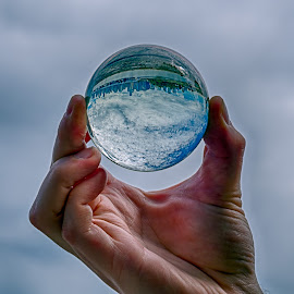 Vancouver, BC, is upside down by Jay Gould - City,  Street & Park  Skylines ( hand, glass sphere, grey sky, handheld sphere, city )