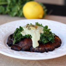 Meaty Portobellos and Lemon Kale Topped with Pumpkin Seed Cream