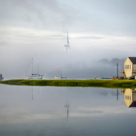 Misty Morn by Ken Mccartney - Landscapes Waterscapes ( water, grass, reflections, yellow, hull, house, boat, massachusetts, mass, fog, tone mapped, windmill, misty, mist )