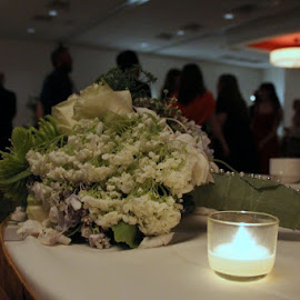 The Bouquet and guests dancing. by Joel McNary - Wedding Reception