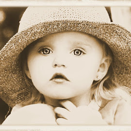 Surprise! by Cheryl Korotky - Babies & Children Child Portraits ( albumum tint, hats, pose, sepia, child model peyton, a heartbeat in time photography, amazing faces, beautiful children, portrait, kids in hats )