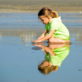 Playing in the wet sand at the beach by Tyrell Heaton - Babies & Children Children Candids
