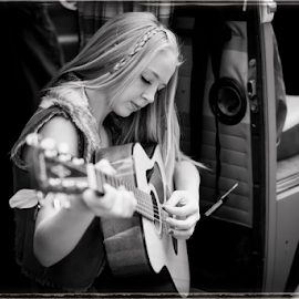 Music is... by Tina Stanley - People Portraits of Women ( music, van, black and white, long hair, beautiful, boho, pretty, young, young lady, country, blonde, girl, chic, woodstock, gorgeous, woman, braids, lady, guitar, gypsy, volkswagon )