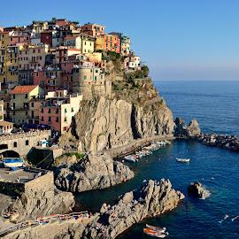 Cinque Terre by Andrzej Pradzynski - City,  Street & Park  Vistas ( shores, cinque terre, village, colorful, liturgia, boats, manarola, rocks, italy )