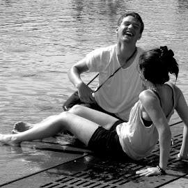 Wet and Happy by Mikki W - People Couples ( laughing, girl, black and white, shorts, france, legs, wet )