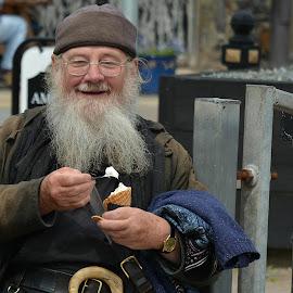 man enjoying ice cream by Denny Larrisey - People Portraits of Men
