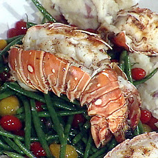 Grilled Spiny Lobster with a Warm Tomato Salad, Garlic Creamed New Potatoes and a Drizzle of White Truffle Oil