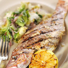 Grilled Whole Snapper with Escarole and Preserved Lemons