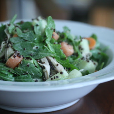 Arugula Salad with Chicken, Black Quinoa, and Lemon-Tahini Dressing