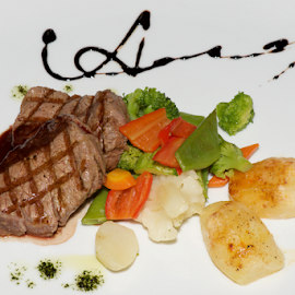 Filet mignon steak with vegetables from above by Nick Dale - Food & Drink Meats & Cheeses ( steak, haute cuisine, peppers, main course, green, potatoes, white, vegetables, plate, restaurant, sauce, filet mignon, red, cauliflower, food, meat, broccoli, carrots, entree, gourmet, china, meal )