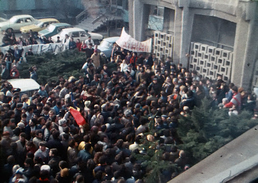 Protesters fill up the inner courtyard of the national television broadcaster