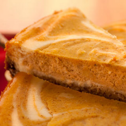 Eggnog Cheesecake with Buttered Rum Sauce