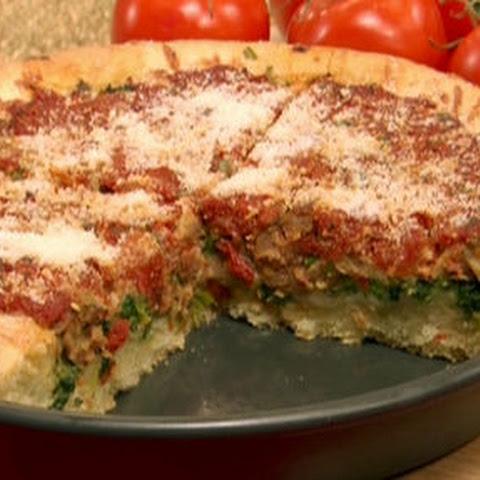 Deep dish pizza with Italian sausage and broccoli rabe