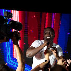 Black singer Akon singing to TV camera by Nick Dale - People Musicians & Entertainers ( concert, t-shirt, fans, white, singer, turkey, bodrum, stage, black, akon )