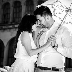 Love and umbrella... by FIWAT Photography - People Couples ( love, black and white, couple )