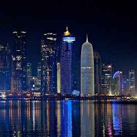 West Bay Skyscrapers by Nashira Usef - City,  Street & Park  Skylines ( water, building, reflection, skyline, west bay, sea, qatar, architecture, towers, serene, doha, night, light, downtown )