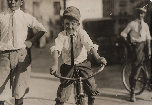 """""""Eleven year old Western Union messenger #51. J. T. Marshall. Been day boy here for five months. Goes to Red Light district some and knows some of the girls."""" — from Hine's field notes, 1913"""