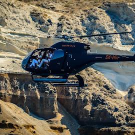 Santorini Paparazzi by Armando Bruck - Transportation Helicopters ( pararazzi, ocean, helicopters, montain, santorini )