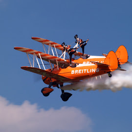 by Stuart Cochrane - Transportation Airplanes ( scotland, dancers, biplane, breitling, smoke, airshow, wingwalker )