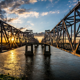 Sunset Between the Spans by Michael Chapman - Buildings & Architecture Bridges & Suspended Structures ( sunset, natchez, mississippi river bridges, natchez bridges, bridges,  )
