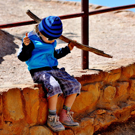 In his own world. by Erin Czech - Babies & Children Children Candids ( stick, blue, utah, waiting, boy )