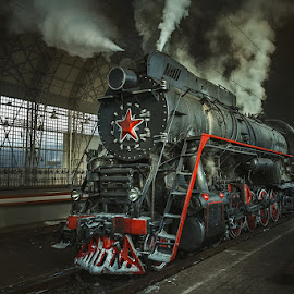 Old Soviet steam locomotive. by Dmitry Laudin - Transportation Trains ( old, technology, wheel, railroad, vehicle, frost, way, retro, travel, transportation, iron, sky, cold, metal, transport, rail, train, industry, motion, black, platform, carriage, vintage, engine, steel, red, winter, railway, blue, locomotive, outdoor, piston, antique, steam )