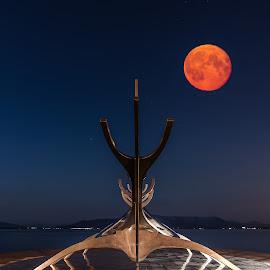 Sólfarið - The Sun Voyager by Arnar Sigurbjörnsson - Buildings & Architecture Statues & Monuments ( sun voyager, monuments, moon, iceland, red, volcano, red moon, reykjavik, pollution, steel, sólfarið, moonrise )
