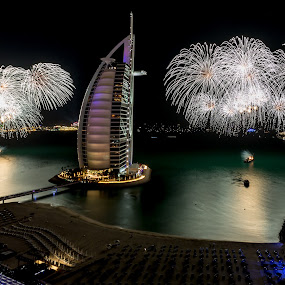 Welcome 2014 in Dubai by Jaideep Abraham - Public Holidays New Year's Eve ( jumeirah beach, 2014, dubai, lightpainting, burj al arab, fireworks, beach )