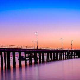 Sunrise at the Pier by Keith Walmsley - Landscapes Sunsets & Sunrises ( lights, nature, boats, pier, sunrise, natural, boardwalk )