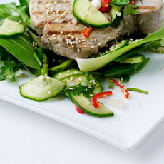 BBQ tuna steaks with cucumber, soy and lime dressing