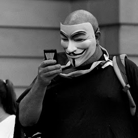 Anonymous, But In Contact by Andrew Rock - News & Events Politics ( film, minolta x-700, australia, protest, kodak tri-x 400,  )