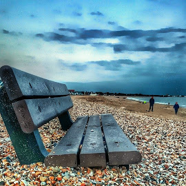 lost at seating... by Clare Sykes - Landscapes Beaches ( seashore, sky, bench, views, silhouettes, pebbles, seashells, beach, beachfront, landscapes, dusk, people )