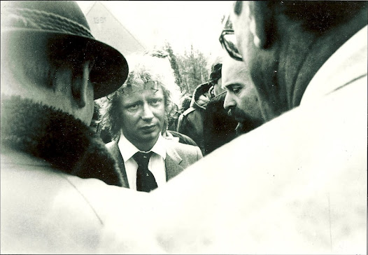 The Stasi cameraman's long lens zooms in. Here he captures my conversation with a group of mourners including (bearded, right) dissident pastor Rainer Eppelman, who would after 1989 become a member of the Bundestag.