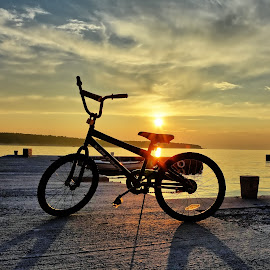 bike and sunset by Adriana Kastelan - Transportation Bicycles