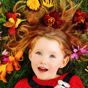 Blossoms In My Hair by Cheryl Korotky - Babies & Children Child Portraits ( red hair, flowers in hair, a heartbeat in time photography, amazing faces, blue eyes, beautiful children, redhead, child model nevaeh, portrait ideas for girls, blue, orange. color, , colorful, mood factory, vibrant, happiness, January, moods, emotions, inspiration )