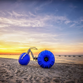 Big Wheel on Biloxi Beach by Stephen Marshall - Transportation Other ( water, sand, tricycle, jet ski, big wheel, sunrise, beach )