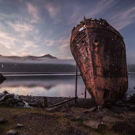 Falling asleep by Bragi Ingibergsson - Transportation Boats ( water, suðurland, old, reflection, mountain, brin, bragi j. ingibergsson, sea, rusty, beach, boat, fjord, iceland, sunset, djúpavík, abandoned )
