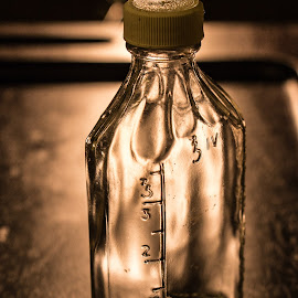 bottle aglow by Elsie Nisonen - Artistic Objects Glass ( iv, elsienisonen, glass, bottle,  )