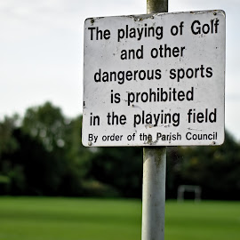 Dangerous Sports by Dunstan Vavasour - City,  Street & Park  Neighborhoods ( sign, games, playing field, parish, golf, dangerous,  )
