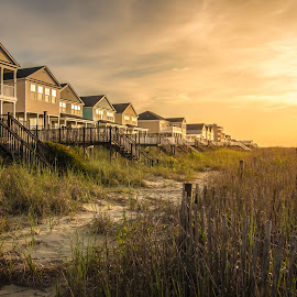 Awaken by Benjamin Coy - Buildings & Architecture Homes ( water, shore, sand, reflection, dunes, waves, sporting, sea, sc, beach, salt water, south carolina, fence, surfside beach, sky, sand dunes, pier, beachfront, sunrise, surf, homes, low country, golden hour )