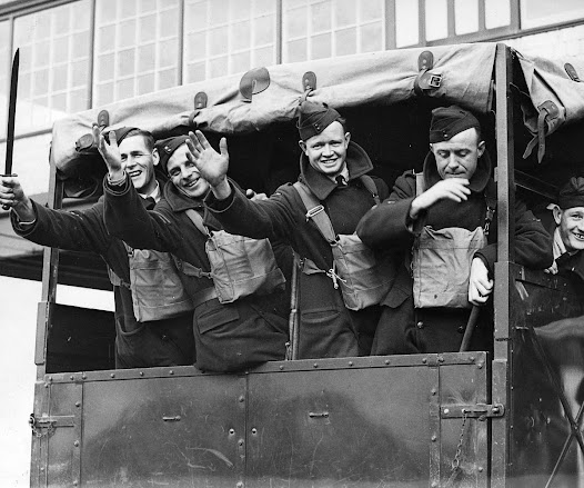 A group of RAAF men put on a happy face before embarking from Port Melbourne, c1940