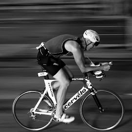 The Lone Racer by Mike Boening - Transportation Bicycles ( panning, bike, olympus omd em1, black and white, speed, racing, sports, ii, chicago, land, device, transportation )