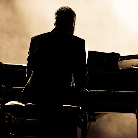 Playing Piano by Albert Bredenhann - News & Events Entertainment