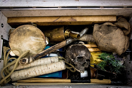 A look inside trunk No. 8 - this trunk carries various musical instruments and key props including Ophelia's flowers, the Gravedigger's shovel and Yorick's skull.