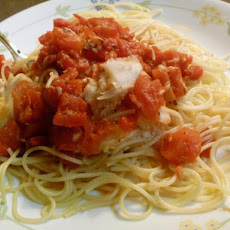 Tilapia Mediterranean over Angel Hair Pasta