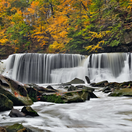 Great Falls of Tinker's Creek by Kenneth Keifer - Landscapes Waterscapes ( stream, seasonal, gorge, colorful, bedford, viaduct, waterfall, blur, flow, leaves, landscape, cleveland, great falls, nature, ohio, autumn, foliage, creek, great falls of tinkers creek, long exposure, motion, rocks, tinkers, water, boulders, park, flowing, cliff, forest, scenic, plunge, woods, tinkers creek, blurred, color, cascade, changing, fall, trees, cataract, october, whitewater )