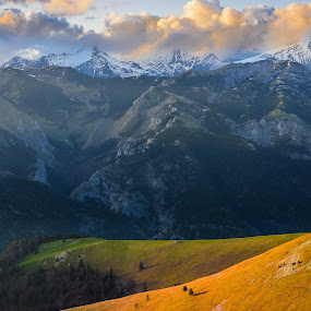 A change of seasons by Lucian Satmarean - Landscapes Mountains & Hills ( mountain, green, sunset, snow, meadow, spring )